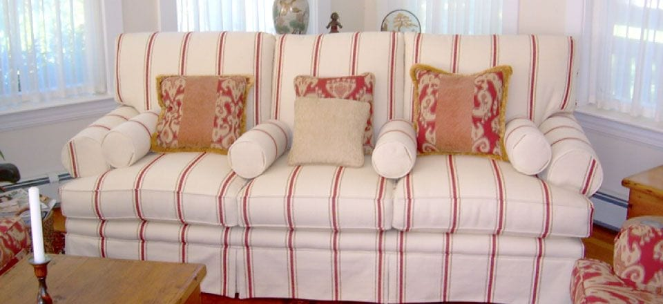 reupholstered sofa with red stripes