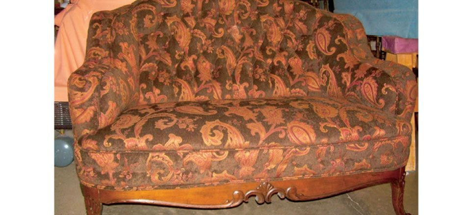 antique loveseat after restoration