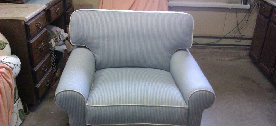 cute light blue reupholstered small armchair
